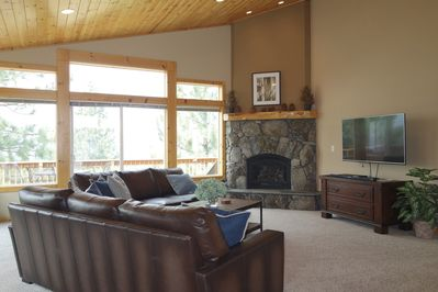 Living Room with fireplace and deck