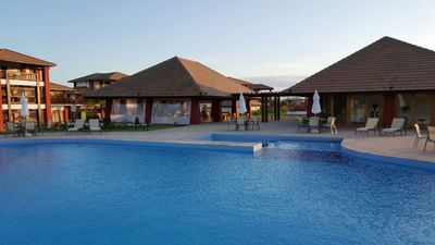 Photo for NEW VILLAGE IN FRONT OF THE BEACH OF NATURAL POOL, 3 BEDROOMS AIR-CONDITIONED