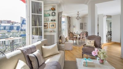 The large French windows make the open living and dining area light and breezy