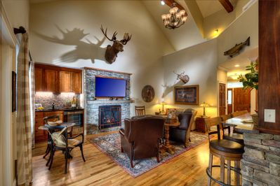 Rustic Main Level Great Room with plenty of seating to cozy up to the fireplace