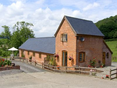Photo for TALOG BARN, pet friendly, with a garden in Tregynon, Ref 977065