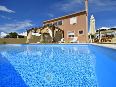Photo for This 5-bedroom villa for up to 12 guests is located in Biograd / Biograd Na Moru and has a private s