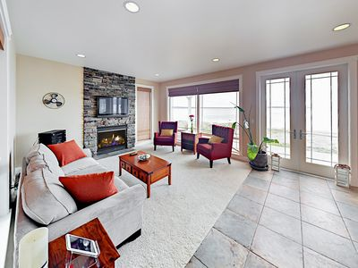 Living Room - The open living area offers ample seating with a plush couch and 2 armchairs.