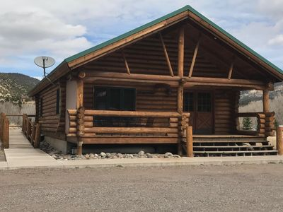 "Photo for LOG CABIN in the"" HEART OF IT ALL"" WITH GUEST ACCESS TO RIO GRANDE GOLF CLUB"