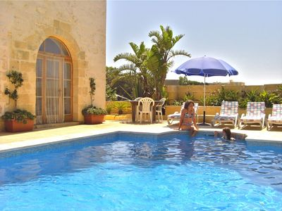 Photo for 17th Century farmhouse, full of character & original features, with private pool