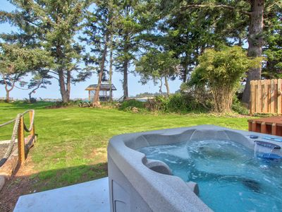 Photo for Charming bayfront & dog-friendly house with private hot tub, beach access!