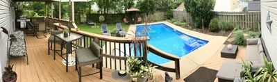 Backyard and pool offers a lot of seating and outdoor fire pit. 3 burner grill