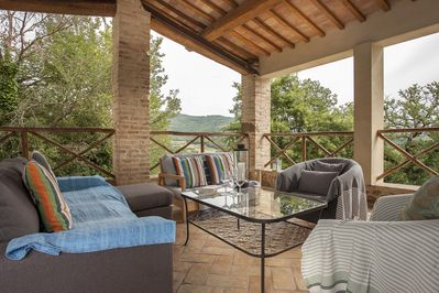Covered terrace with views,comfortable seating perfect for relaxing in the shade