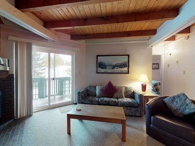 Photo for Homey condo w/ shared pool & hot tub, patio, wood fireplace, and mountain views!