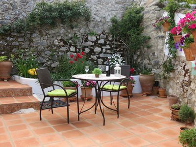 Pretty and private rear patio accessed from lounge.