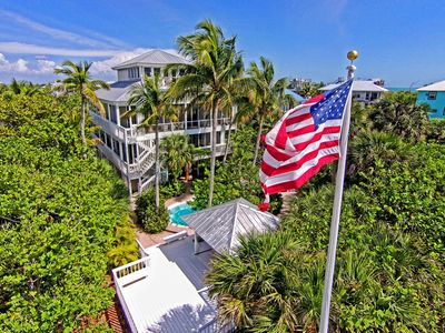 aerial view of house from beach side showing heated pool gazebo private walkway