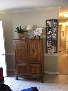 Side view of living room, has tv, cable