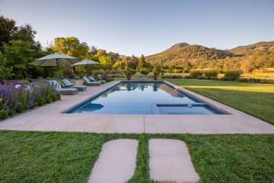 Large solar heated pool and built in hot tub with gorgeous views