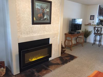 View of fireplace that you turn on with a click of your finger and new TV.