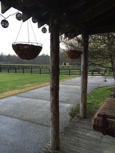Relaxing on the porch. View of another Run-In Barn.