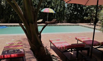 B & B Villa Calliandra, room with kingbed and ensuite bathroom  with large pool.