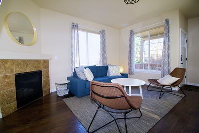 Comfy modern living room with a smart TV and HDMI cable ready for you.