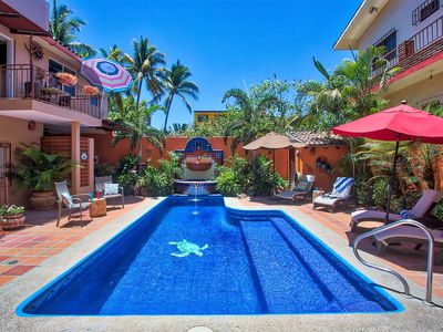 Photo for TRES PALMAS~ LUXURY~1 BED/1, 1/2 BATH~1block to beach~heated pool~A/C~security