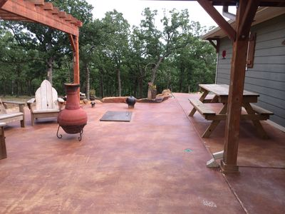 Large patio area with a built in storm shelter.