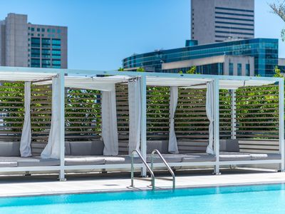 Photo for Ultimate Downtown condo with Gorgeous Pool & Gym