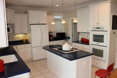 Alternate view of the wonderful kitchen with gas cooktop in the island.