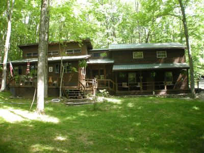 Photo for Loft efficiency surrounded by mature oaks. Sleeps 4, with pool access.