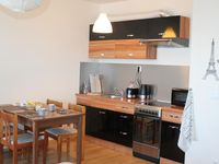 Nice apartment with balcony and great shopping. 1. min. walk to the trolley that runs to the center