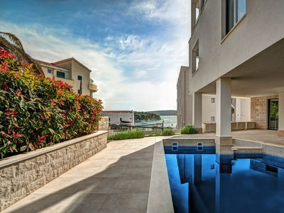 Photo for This 7-bedroom villa for up to 14 guests is located in Okrug Gornji and has a private swimming pool,