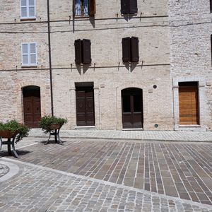 Photo for apartment in an ancient medieval building in the central square of Moresco