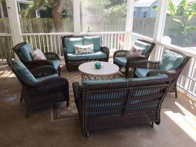 A big and breezy screen porch with confortable conversation area.