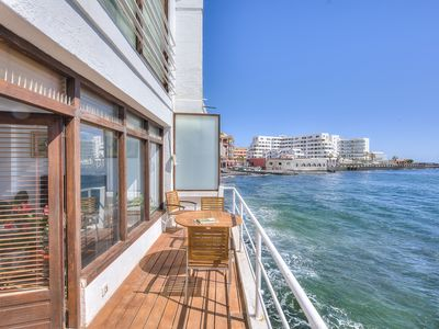 Photo for HOUSE OVER THE SEA ( touching the water) VERY CENTRAL EL MEDANO, BBQ terrace,