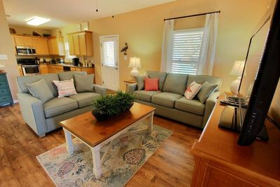 Living room w/sleep sofa, love seat, dining and end tables and flat screen TV/DVD