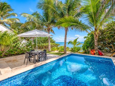 Photo for Cozy beachfront condo with private swimming pool -Wifi, AC, Kayaks