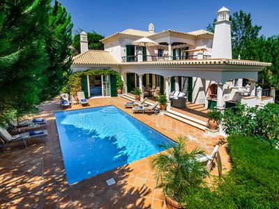 Photo for Luxury Dunas Douradas villa with heated pool, WiFi, air-conditioning. Sleeps 10. Walk to beach ER09
