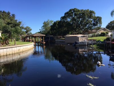 View of the canal from the dock. Watch the ducks, otters, birds and fish go by.