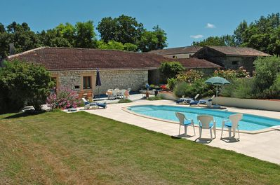 swimming pool and back of gites