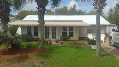 Photo for FAMILY FRIENDLY AND BIG FENCED IN YARD.  EXTRA LOT FOR MORE ROOM AND PARKING