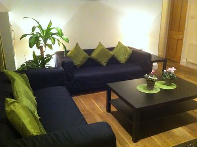 The sitting room has space, big comfy sofas, plus a flat-screen TV (out of shot)