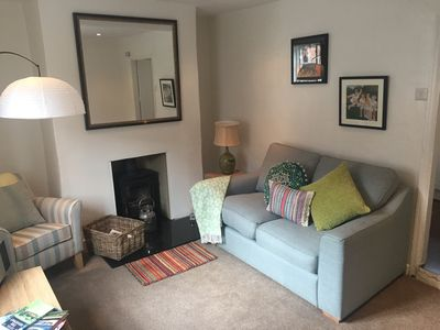The cottage living room comprises of arm chair, sofa & lovely wood burner