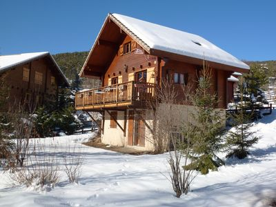 Photo for Unique wooden individual chalet, sleeps 8 to 10, quality environment