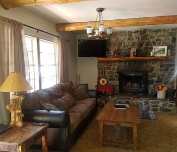 Photo for Updated mountain side two story cabin! Minutes from town, perfect for families!