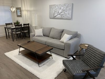 Open living room and dining area with seating for 4.