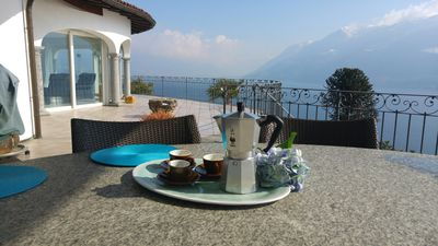 Photo for Pure luxury, large villa with heated pool, 180 ° view of Lake Maggiore.