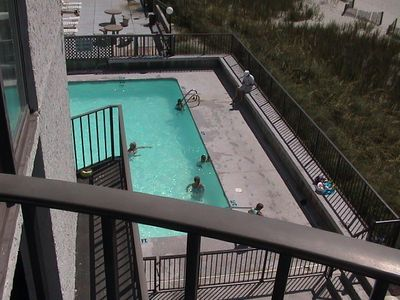 Large swimming pool. View from balcony. First floor,but 2 levels of parking underneath. So you are not subjected to pool noise