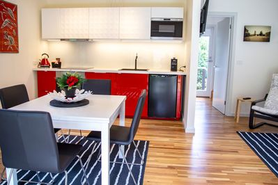 Modern kitchen to include dishwasher, microwave and coffee machine.