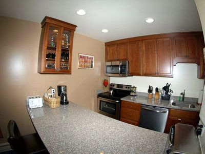 New cabinets that are soft closing bar stools to counter, stainless appliances