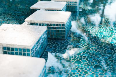 Walkway and Glass Tiled Water Curtain.