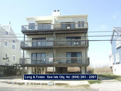 Photo for Cross the street to the beach!! This suite also has a private deck with skyline views of the coastline. Off street parking