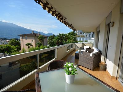 Photo for Stylish apartment with a panoramic terrace offering spectacular views of Ascona