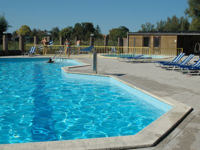 Photo for Close to the beach comfortable holiday house with garden, in the park with playground and pool